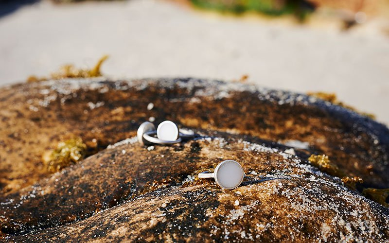 Rings on a rock on the beach.