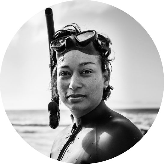 Aaniyah Omardien profile shot wearing a wetsuit and goggles.
